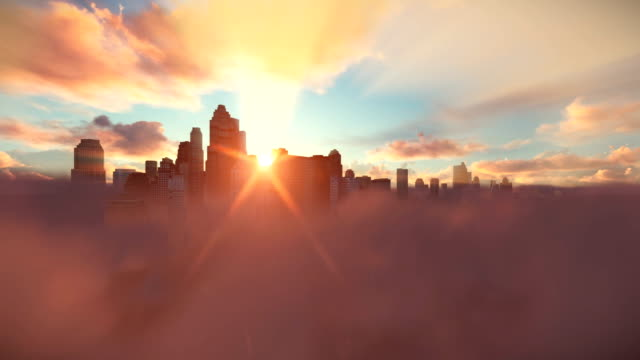 City skyline above clouds, timelapse sunrise video