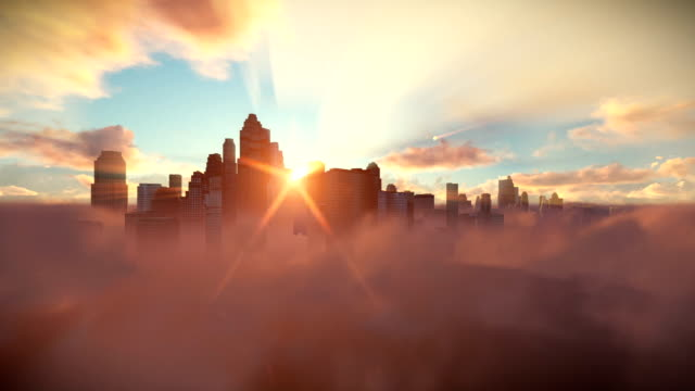 vídeos de stock e filmes b-roll de city skyline above timelapse clouds at sunrise - above the clouds