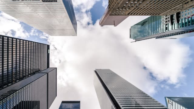 City Skyline Skyscrapers Futuristic Downtown Toronto office buildings Futuristic lookup at skyscraper office building architecture in the downtown Toronto, Ontario Canada financial district. White clouds pass through a blue sky during the day. financial building stock videos & royalty-free footage