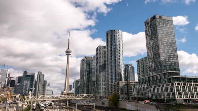 city skyline trains travelling in toronto - toronto architecture stock videos & royalty-free footage