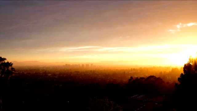City Timelapse A dramatic timelapse over Oakland, California.  The clouds change color as the sun gets lower. oakland stock videos & royalty-free footage