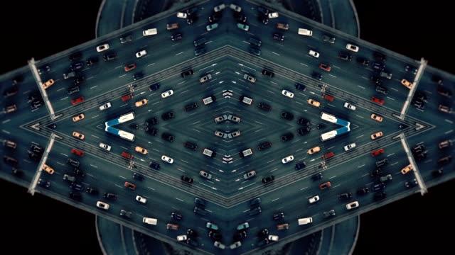city traffic. aerial background. mirror effect - узор калейдоскоп стоковые видео и кадры b-roll