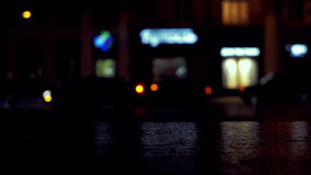 City traffic at night. Defocused shot. 4K video