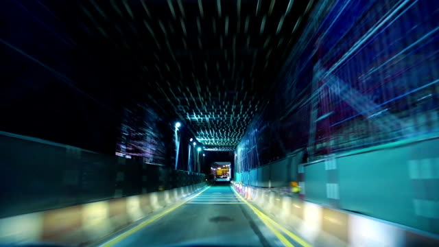City traffic at night, the car travels through the tunnel video