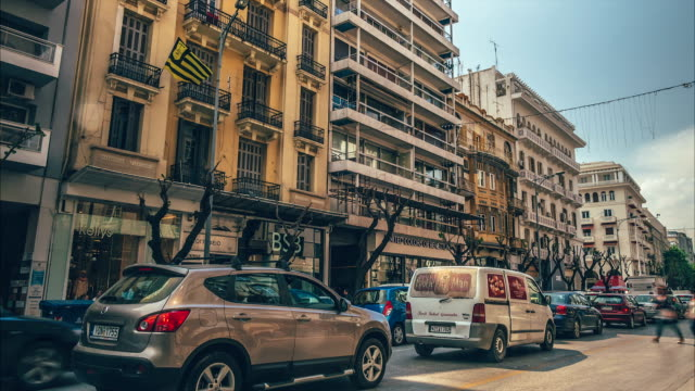 City traffic drives forward during rush hour, Thessaloniki, Greece video
