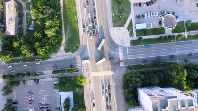 City traffic street crossroad in the rays of the setting sun. Drone footage Sunny summer evening, Russia, Yoshkar-Ola, city traffic street crossroad aerial top down panorama. Drone footage fork stock videos & royalty-free footage