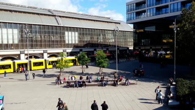 City tram arriving at Alexanderplatz, Berlin. People walking across the video