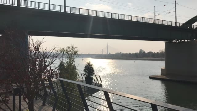 City view of bridge on Sava river with sun reflection on water