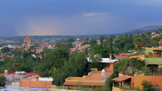 City view of Parroquia Church in San Miguel de Allende Mexico with storm video