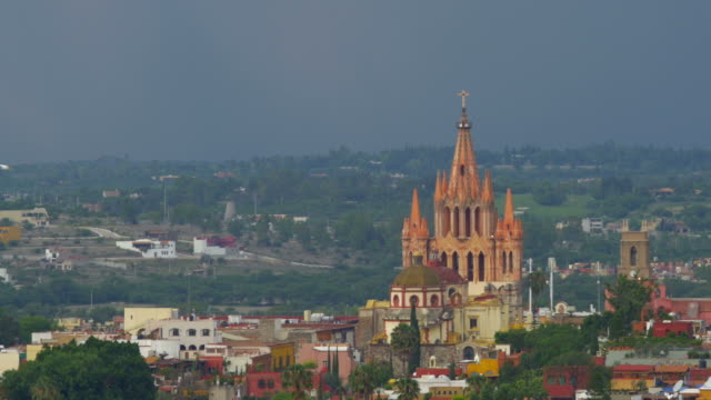 City view of the Parroquia church in San Miguel de Allende sunset with egrets video