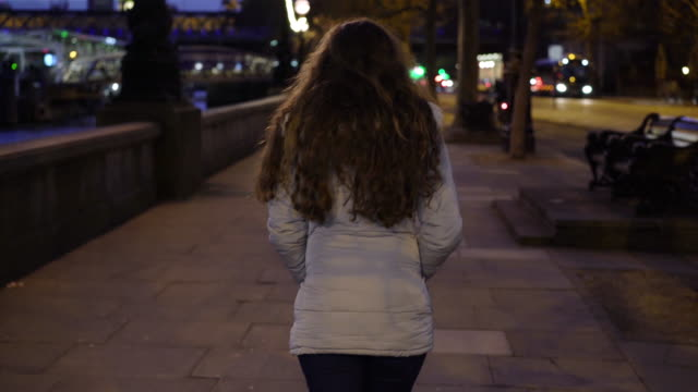 city walking, rear view young woman. - homelessness stock videos & royalty-free footage