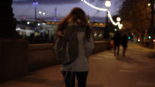city walking, rear view young woman with a rucksack. - homelessness stock videos & royalty-free footage