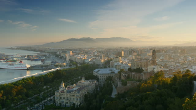 Cityscape aerial view of Malaga, Spain. Panning shot. UHD, 4K video