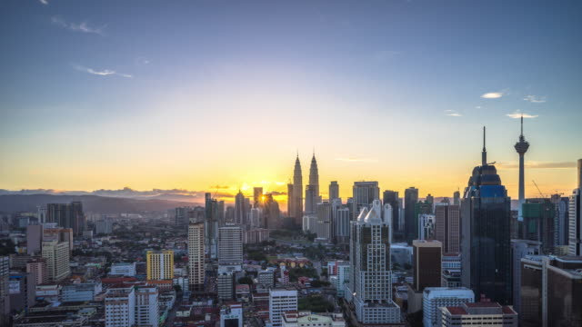 cityscape and skyline of kuala lumpur at sunrise. time lapse - malese video stock e b–roll