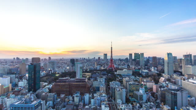 cityscape and skyline of tokyo at sunset. time lapse video