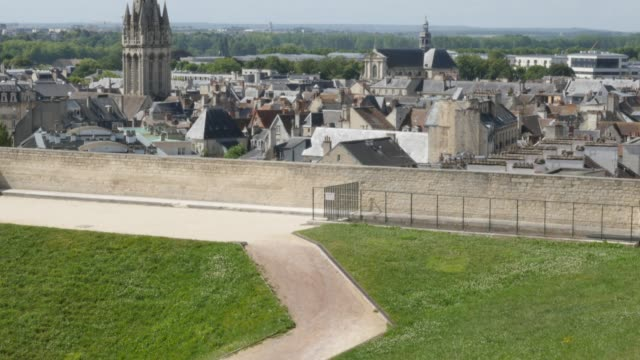 Cityscape of Calvados capital Caen in France 4K Cityscape of Calvados capital Caen in France 4K 3840X2160 UltraHD 30fps tilting footage - City of Caen located in northern French region Normandy slow tilt  4K 2160p UHD video caen stock videos & royalty-free footage