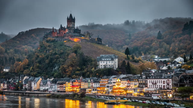Cityscape of Cochem and the River Moselle in Germany - Day to Night Time Lapse