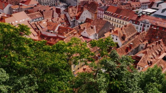 cityscape of graz in austria. a beautiful european city, a popular tourist destination. tilt shot - styria filmów i materiałów b-roll