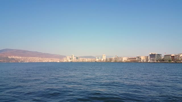 Cityscape of Izmir from a boat trip on a sunny day. Cityscape of Izmir from a boat trip on a sunny day. izmir stock videos & royalty-free footage