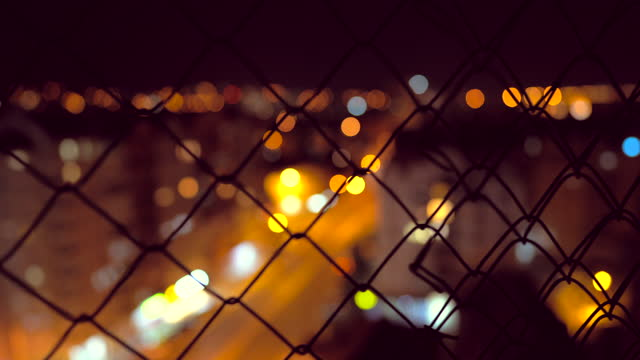 Cityscape through chainlink fence