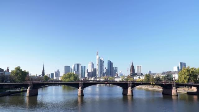 cityscapes of frankfurt under clear sky in autumn, germany - francoforte sul meno video stock e b–roll