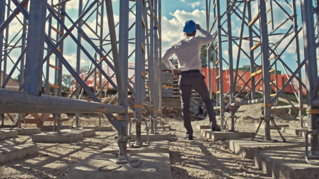Civil engineer checking the construction site video