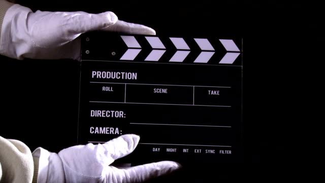 vidéos et rushes de clapperboard séquence - ardoise