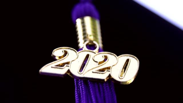 class of 2020 graduation ceremony tassel black - graduation cap stock videos & royalty-free footage