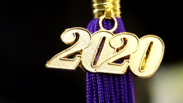 class of 2020 graduation ceremony tassel black - celebrazione della laurea video stock e b–roll