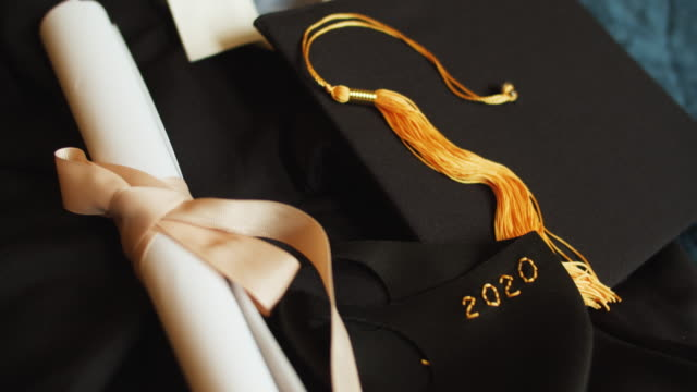 Class of 2020 graduation gown and cap with protective mask due to COVID-19 pandemic