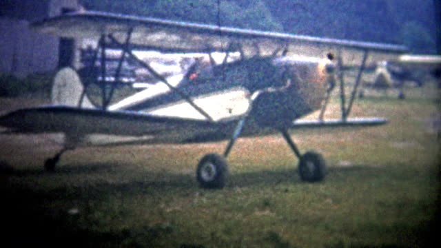 AMITYVILLE, NY. USA  - 1954: Classic biplane taxiing across Zahn's airfield. video