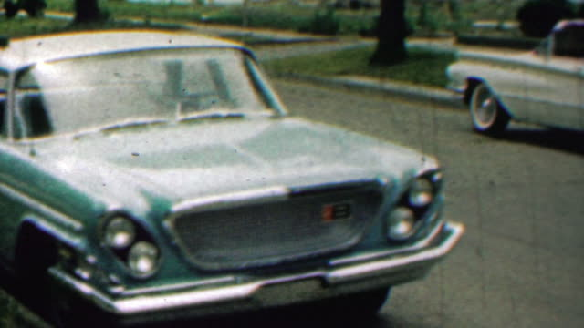 1962: Classic blue car parked in residential street. video