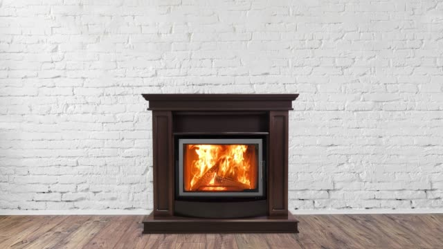 Classic burning fireplace in the interior. Brick wall background