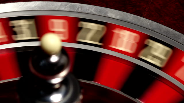 Classic casino roulette wheel, on black, ball white video