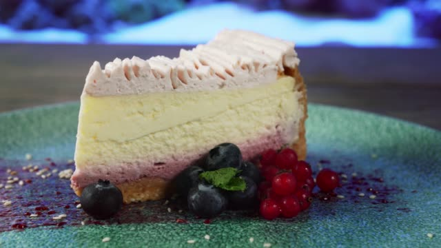 Classic cheesecake with berries on plate.