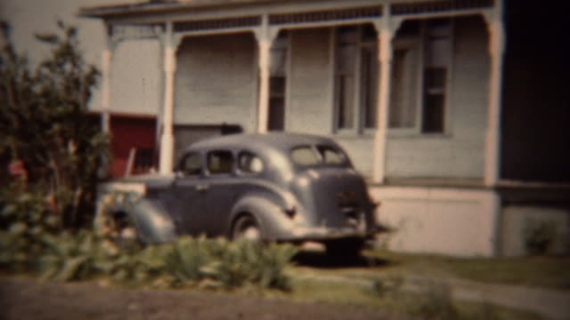1962: Classic gray Dodge car parked suburban house driveway. video