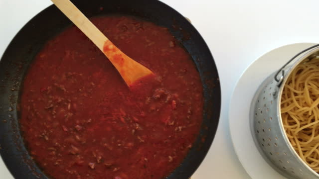 Classic homemade Spaghetti Bolognese Classic homemade Spaghetti Bolognese cooked ingredients inside kitchen cooking utensils and equipment and Spaghetti Bolognese meal served in a plat. macaroni stock videos & royalty-free footage