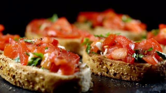 Classic Italian bruschetta, tomato, garlic and parsley on toasted bread video