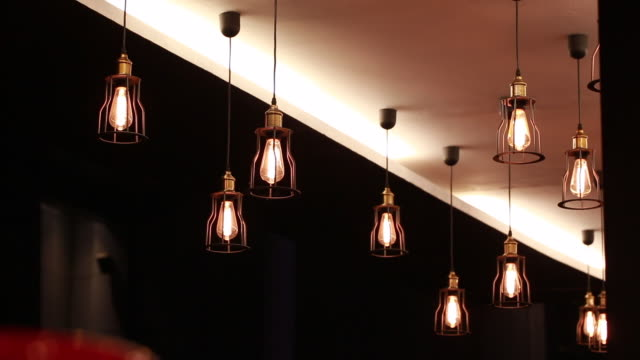 classic lamp at the ceiling in modern restaurant - vintage architecture stock videos & royalty-free footage