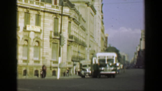 1952: Classic municipal bus transportation shuttles downtown city streets. video