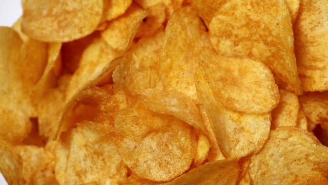 Classic potatoe chips rotating Classic golden potatoe chips rotating potato chip stock videos & royalty-free footage