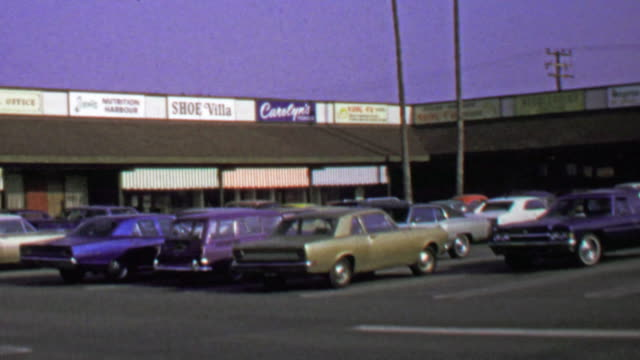 1974: Classic suburban strip mall independant small business owners. video