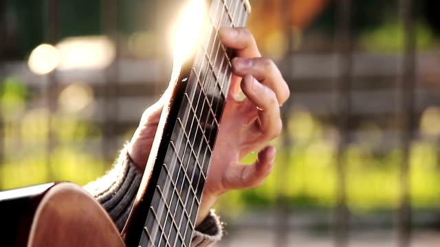 classical guitarist playing: street artist, singer, classic guitar video