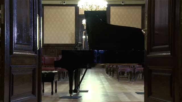 Classical Piano In An Elegant Salon. The Door Of The Room Opens.
