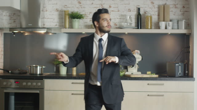 Classy and Handsome Young Businessman Dances Energetically at His Kitchen. video