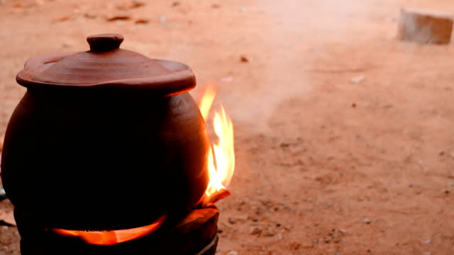 Clay pot on the stove with smoke