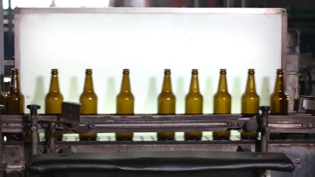 Clean bottles are moving along the conveyor - video