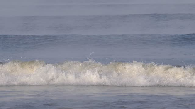Clean Sea Waves Covered with Fog Slow Motion