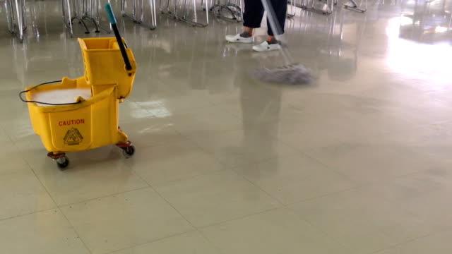 Clean the floor in canteen. video