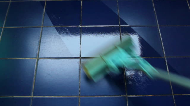 Clean the tiles with a sponge mop. video